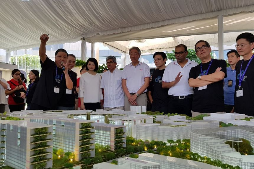 DPM Teo Chee Hean (centre), Ms Sun Xueling (third left), Mr Yaacob Ibrahim (fourth left), Mr Lawrence Wong (fourth right) and Mr Janil Puthucheary (third right) at the launch of the masterplan for the Punggol Digital District.