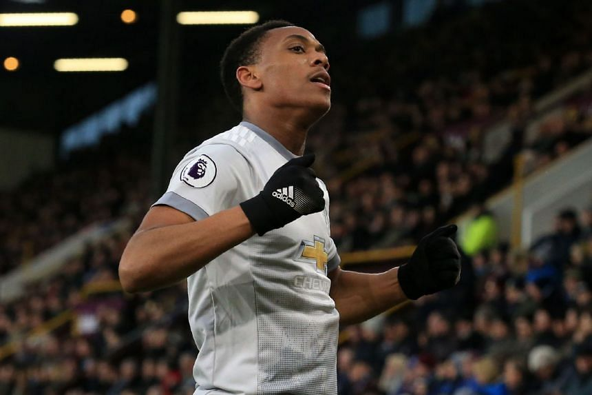 Manchester United's French striker Anthony Martial celebrates after scoring.