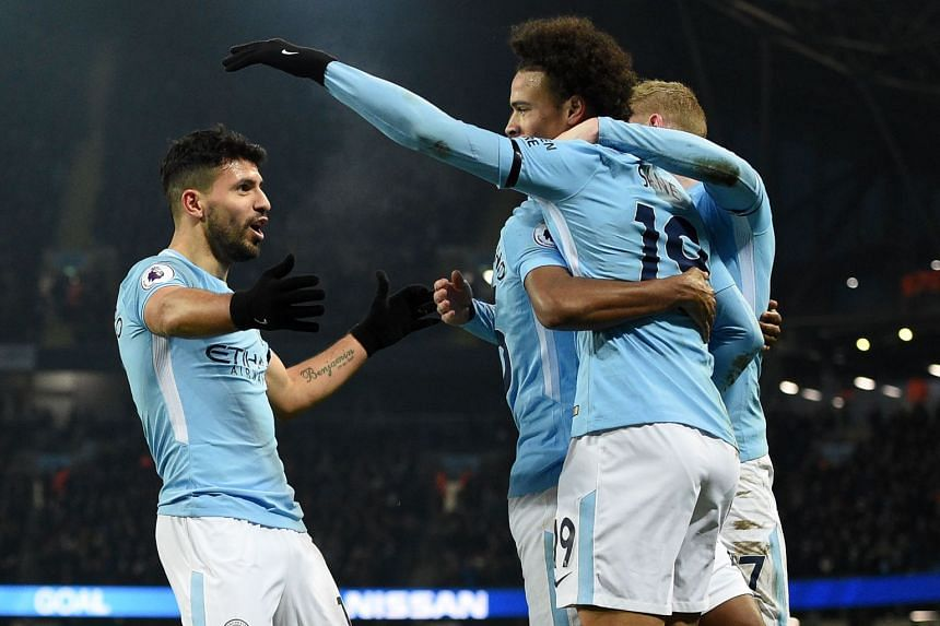 Aguero (left) celebrates with teammates after scoring his and Manchester City's third goal.