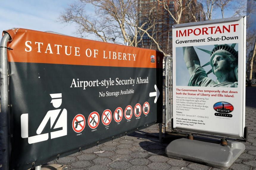 A sign announcing the closure of the Statue of Liberty, due to the US government shutdown, near the ferry dock to the Statue of Liberty at Battery Park in Manhattan, New York on Jan 20, 2018.