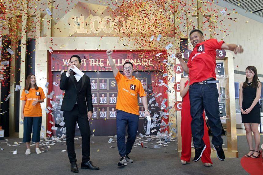 Mr Oddie Rehatta (right) took home the $1 million cash prize on Jan 21, 2018, while Chinese baseball coach Zhang Xuchao won a new Volvo S90 T5.