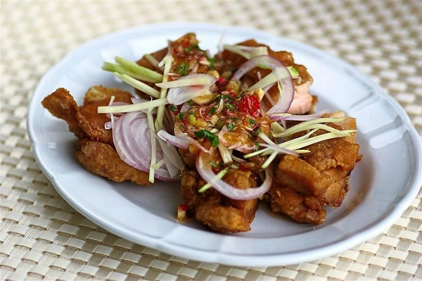 Fried Chicken Chop With Tangy Kerabu Sauce.