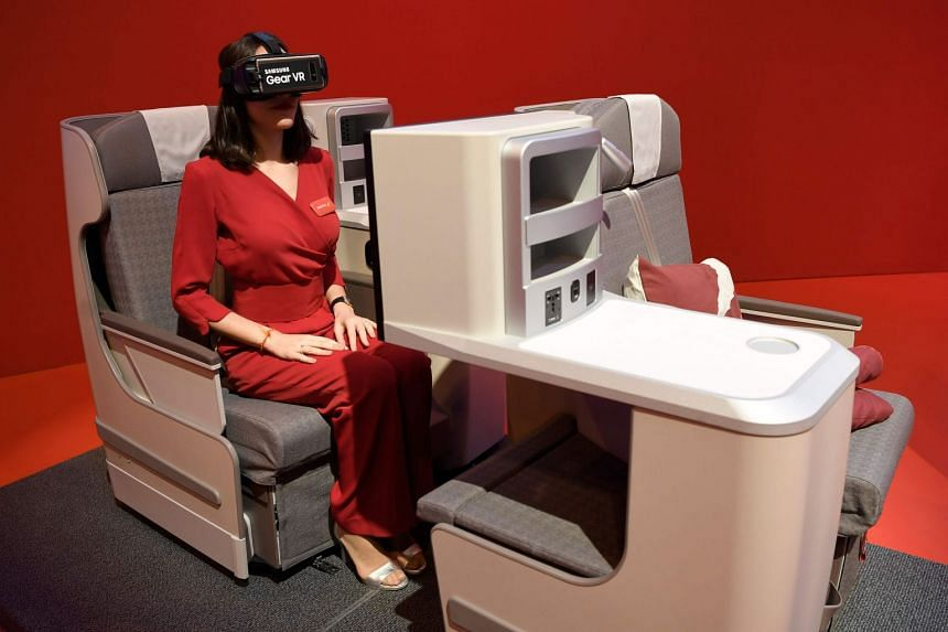 A hostess uses virtual reality glasses at the Iberia stand during the International Tourism Fair in Madrid, on Jan 17, 2018.
