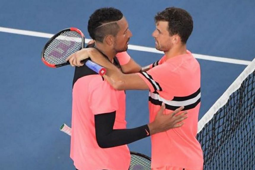 Grigor Dimitrov (right) of Bulgaria is congratulated by Nick Kyrgios of Australia after winning their fourth round match at the Australian Open Grand Slam tennis tournament in Melbourne, Australia, on Jan 21, 2018.
