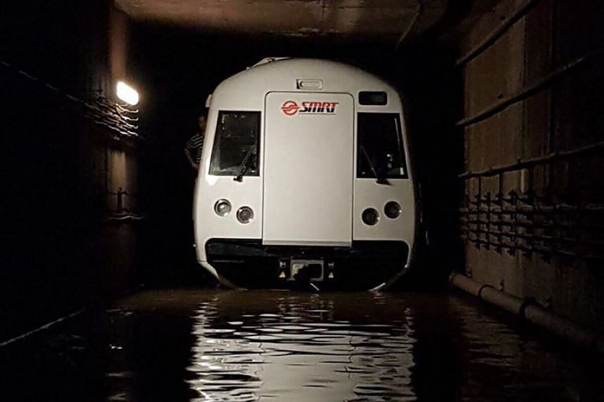 A stalled train in the flooded tunnel between Bishan and Braddell MRT stations on Oct 7, 2017.