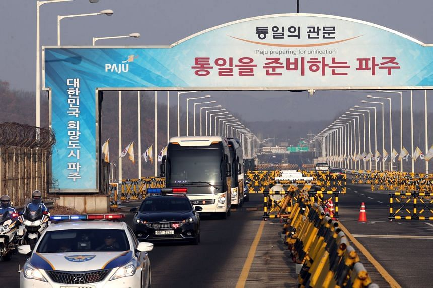 A bus transporting a North Korean team which will inspect an art venue for the 2018 PyeongChang Winter Olympics arrives on the Grand Unification Bridge in Paju, South Korea on Jan 21, 2017.