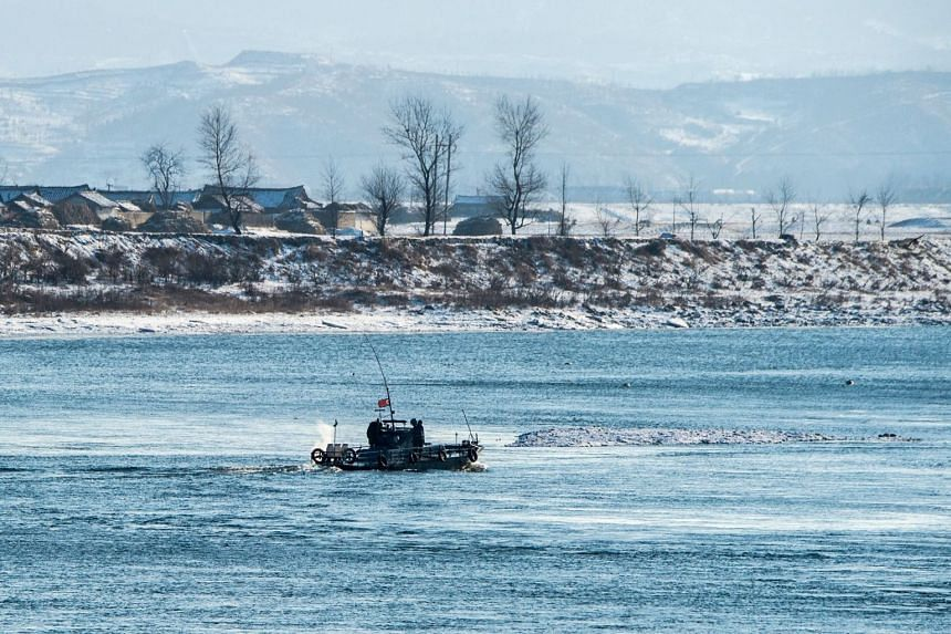 A North Korean naval boat patrols on the Yalu river in North Korea's Sakchu county, seen from the Chinese border city of Dandong on Jan 10, 2018.