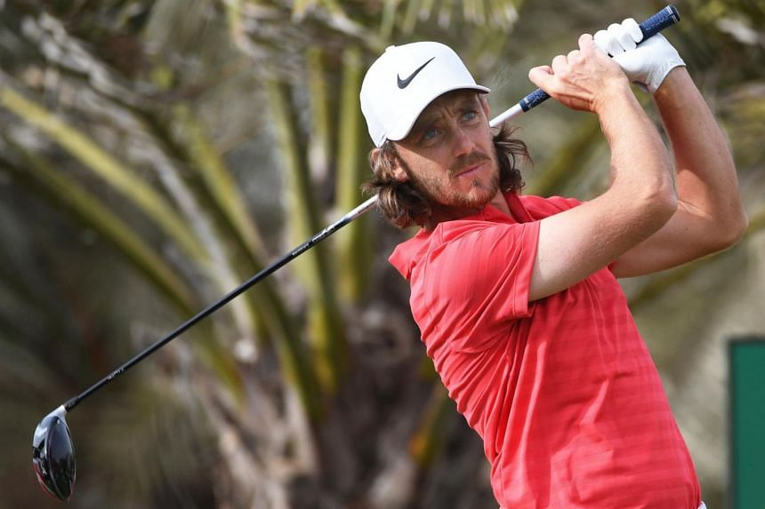 English golfer Tommy Fleetwood tees off at the 14th hole during the final round of the Abu Dhabi Golf Championship in Abu Dhabi, United Arab Emirates, on Jan 21, 2018.
