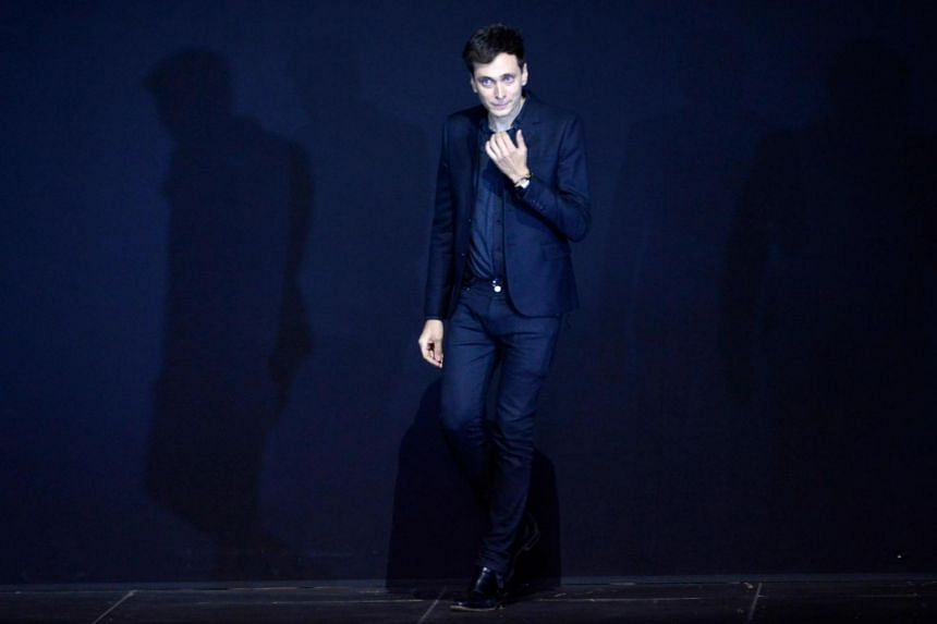 Designer Hedi Slimane acknowledging the public at the end of the Saint Laurent Spring/Summer 2013 ready-to-wear collection show in Paris, France, on Oct 1, 2012.