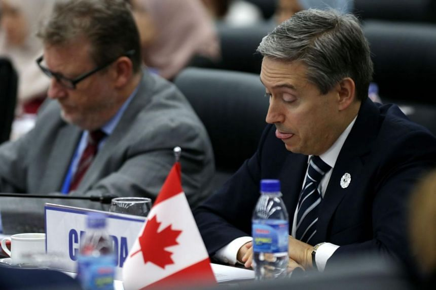 Canada's Trade Minister François-Philippe Champagne (right) attending the Trans-Pacific Partnership Ministerial Meeting on Nov 9, 2017.