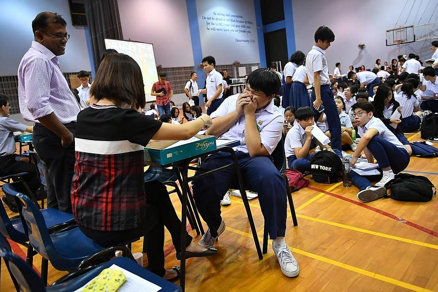Darren Lim receiving his GCE O-Level examination results at Presbyterian High School on Jan 12. Finding out the other areas your child excels in beyond academics will help to build up his confidence.