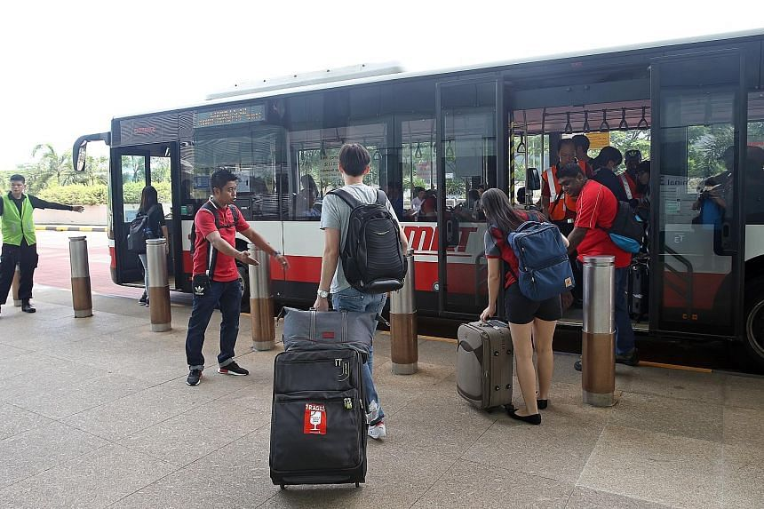 Travellers boarding a shuttle bus at Changi Airport Terminal 3 yesterday, when the Changi Airport MRT station was closed.