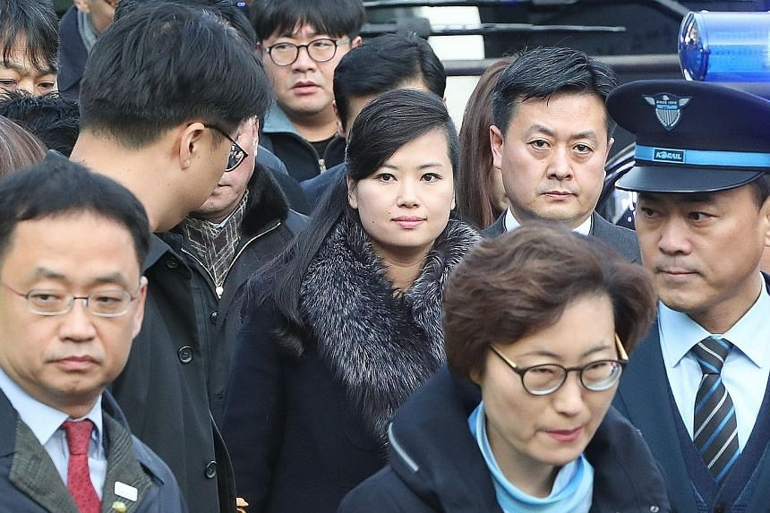 Ms Hyon Song Wol (centre), leader of North Korea's popular all-female Moranbong Band, arriving at Seoul station yesterday. The delegation she led - to prepare for cultural performances during next month's Winter Olympics in Pyeongchang - was slated t