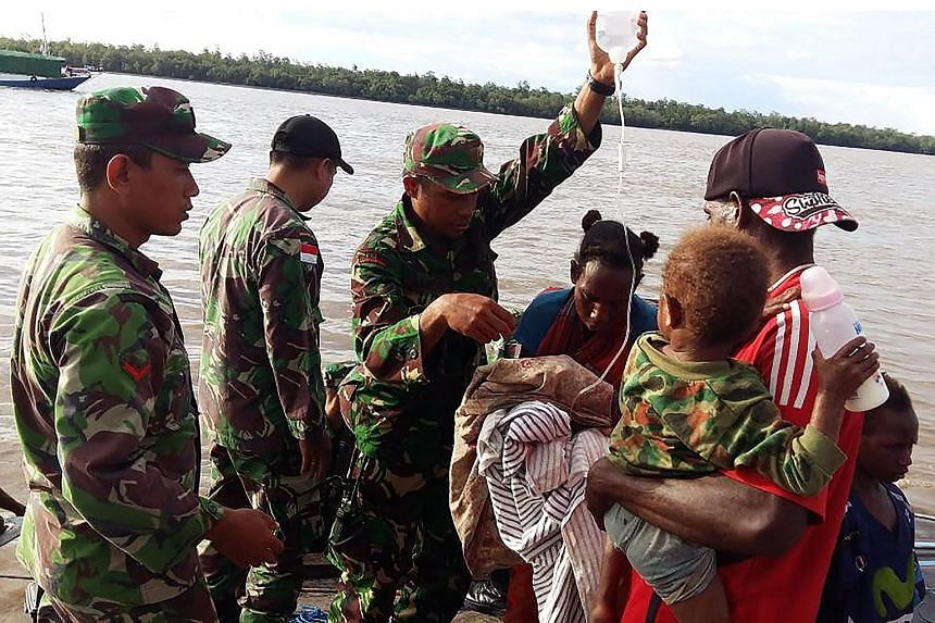 Indonesian military helping to transport children suffering from malnutrition in Asmat. The government and military have sent medical teams there and are supplying villagers with medicine, and food.
