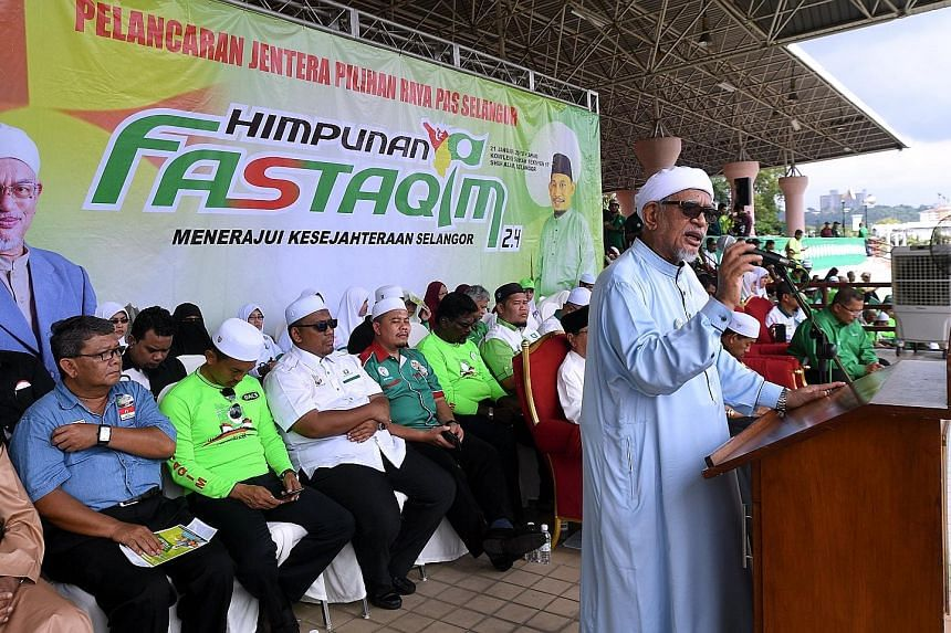 PAS president Abdul Hadi Awang speaking at a party function in Shah Alam yesterday. The Pakatan Harapan opposition alliance worries that PAS' decision not to work with it will cause multiple three-cornered fights that will benefit BN.