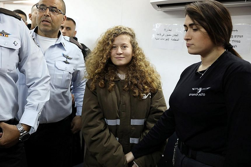 Ahed Tamimi being escorted into a military courtroom at Ofer Prison near Ramallah last week. She could face jail over an altercation in front of her house last month involving Israeli soldiers.
