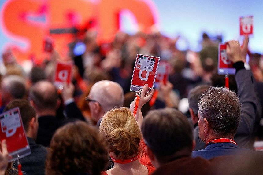 """Social Democratic Party delegates at the gathering in Bonn yesterday to vote on whether the party should go ahead with the talks. A """"no"""" vote would prolong a four-month political deadlock and could result in a new election or what would be Germany's"""