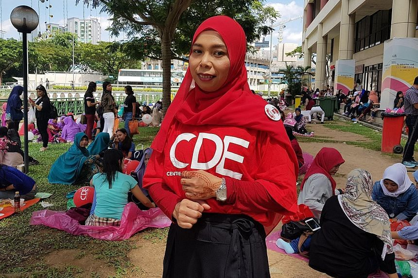 Indonesian domestic worker Rusmawati at the Centre for Domestic Employees' second anniversary celebration at City Plaza yesterday. The centre has made information on maids' rights more accessible, she said.
