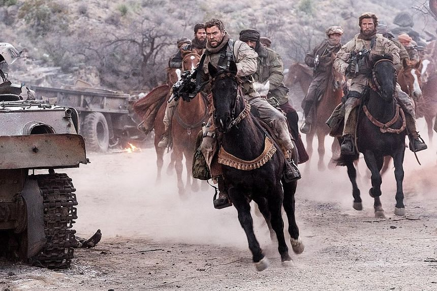 Chris Hemsworth leads the charge as Special Forces Captain Mitch Nelson in 12 Strong.