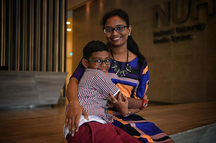 Left: Eight-year-old Marully Ioseff Benjamin and his mother, Madam Mislia Supar, 42, are both part of the Growing Up in Singapore Towards Healthy Outcomes study. Madam Mislia is married to Mr Marully Uhum Reduan, 46, and they have two other children,