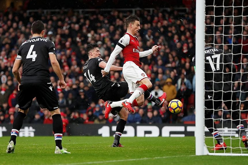 Arsenal centre-back Laurent Koscielny bundling home their third goal in a 4-1 thrashing of Crystal Palace at home on Saturday. The contest was effectively over after four goals in the first 22 minutes as the Gunners prepare for the imminent signing o