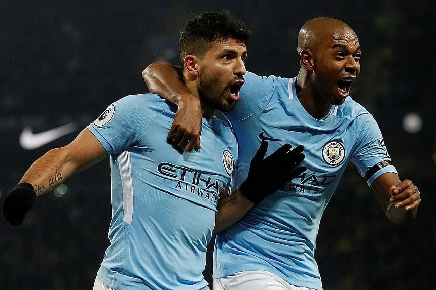 Sergio Aguero, celebrating with Fernandinho after completing his treble, has scored the EPL's first perfect hat-trick (header, left foot, right foot) since he netted one against Newcastle in October 2015.