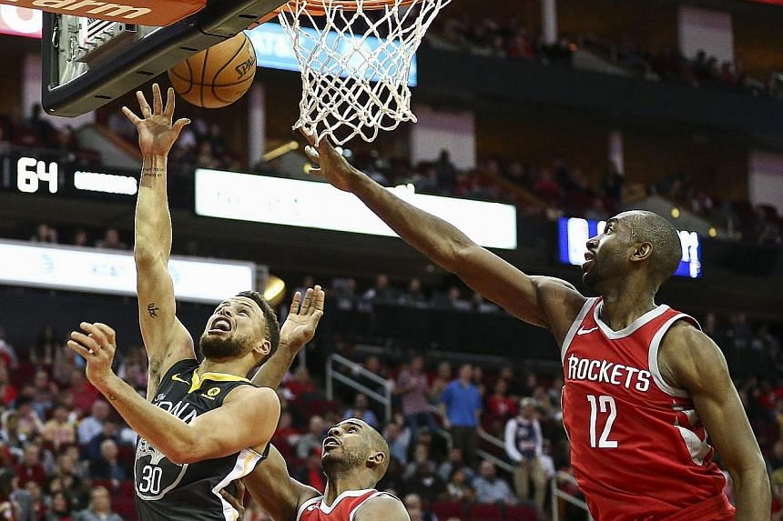Golden State Warriors guard Stephen Curry (30) shoots in the third quarter during the 116-108 defeat by the Houston Rockets. The victory gave Houston a 2-1 regular-season series advantage over the reigning champions and snapped their 14-game winning