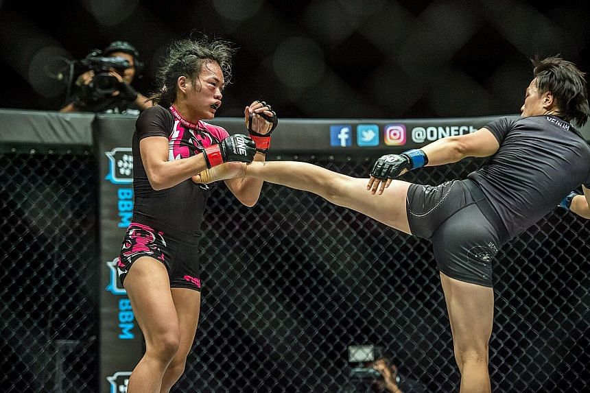 Xiong Jingnan landing a kick on Tiffany Teo's chest during their One Championship strawweight fight in Jakarta. The Chinese won on a TKO by referee stoppage.