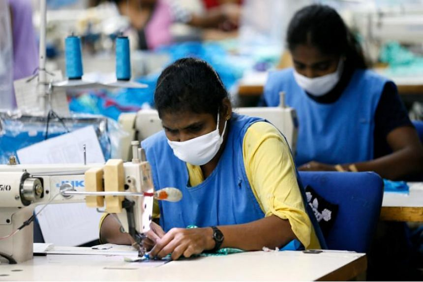 """Garment workers sew skirts at a factory in Sri Lanka on Nov 2, 2017. Oxfam also emphasised the plight of women workers, who """"consistently earn less than men"""" and often have the lowest paid, least secure jobs."""