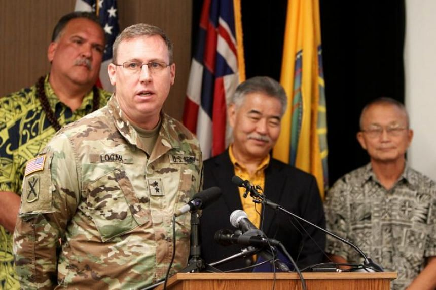 US Army Maj Gen Arthur J Logan (second left) speaks at a news conference, along with Kauai Mayor Bernard Carvalho (left), Hawaii governor David Ige (second right) and Vern Miyagi, administrator for the Hawaii Emergency Management Agency in Hawaii on