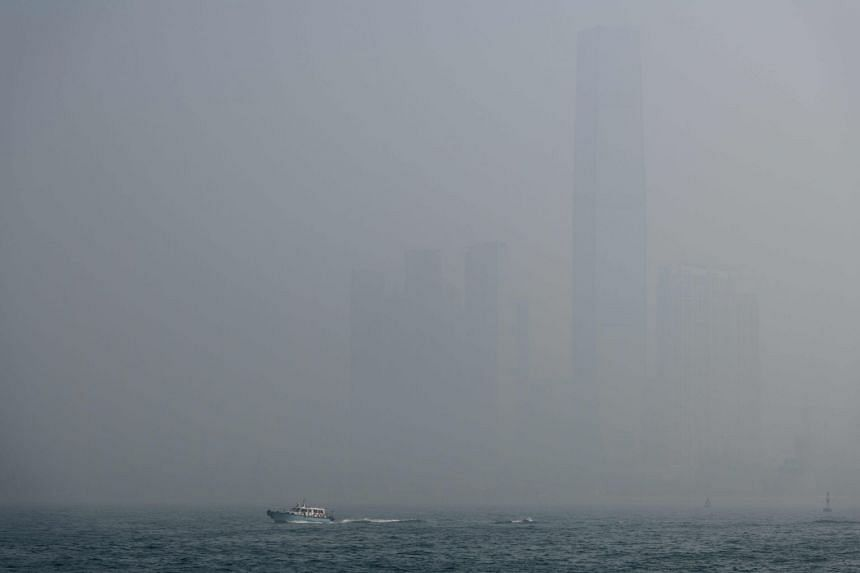 A boat speeding past the ICC building amid thick smog in Victoria Harbour, Hong Kong, on Jan 22, 2018.