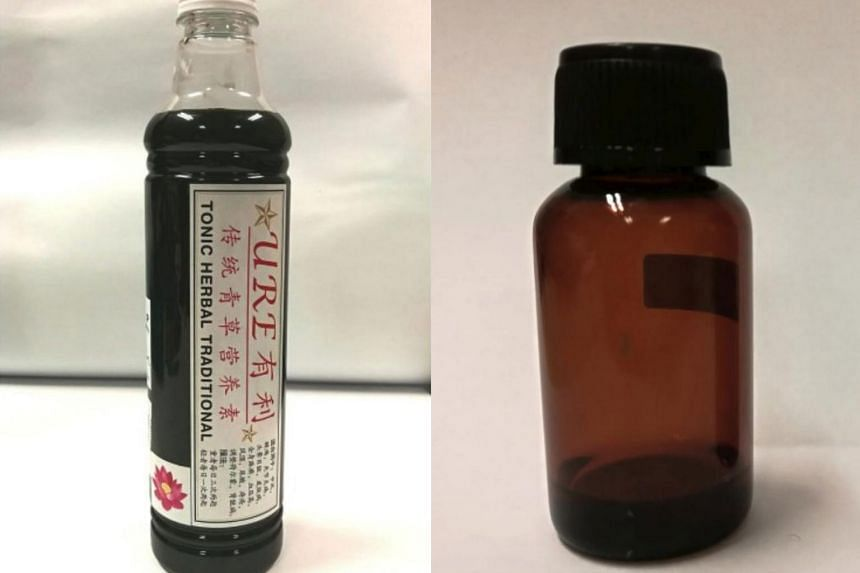 The products deemed illegal are: URE Tonic Herbal Traditional (left), which was sold by a practitioner in Malaysia; and unlabelled bottles of facial solution sold at Dhoby Xchange in Dhoby Ghaut.