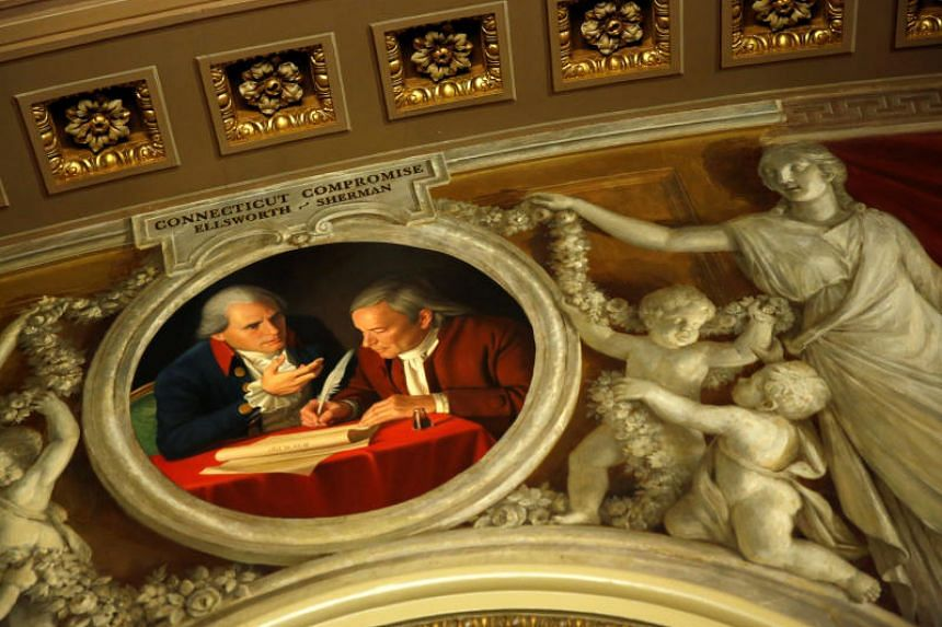 A painting showing 18th century politicians Oliver Ellsworth and Roger Sherman working out the Connecticut Compromise is displayed near the Senate Chamber after President Donald Trump and the US Congress failed to reach a deal on funding in Washingto