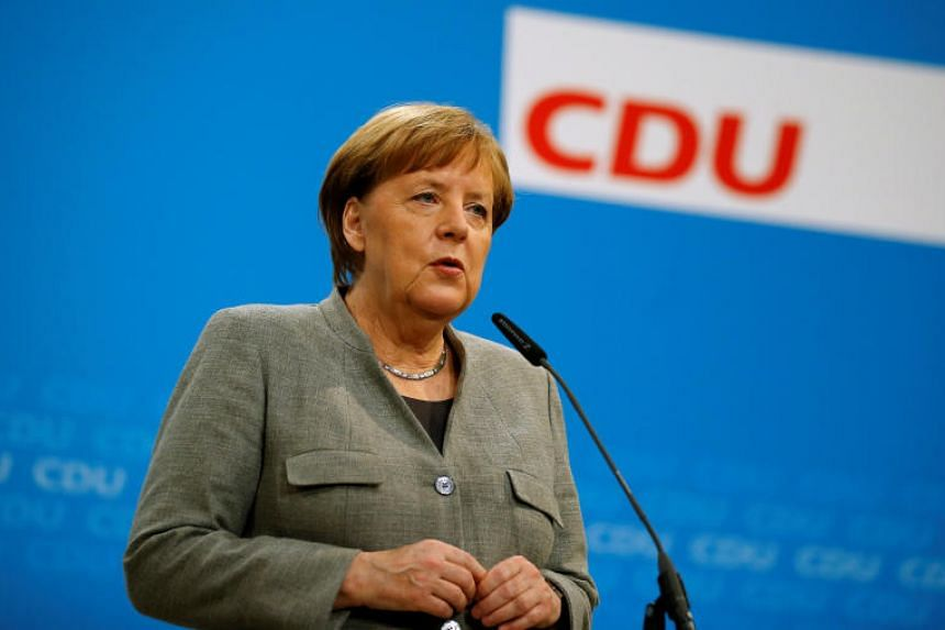 German Chancellor Angela Merkel gives a statement at the CDU headquarters in Berlin, Germany, Jan 21, 2017, after Germany's Social Democrats (SPD) voted to begin formal coalition talks with Chancellor Merkel's conservatives.