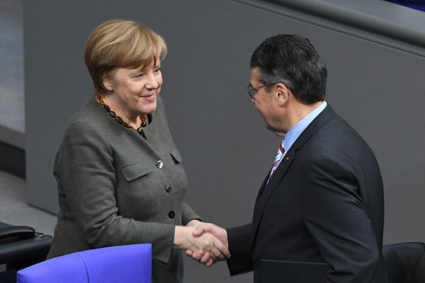 German Chancellor Angela Merkel and Sigmar Gabriel, Germany's acting Foreign Minister from the Social Democratic Party at the Bundestag lower house of Parliament in Berlin on Jan 22.