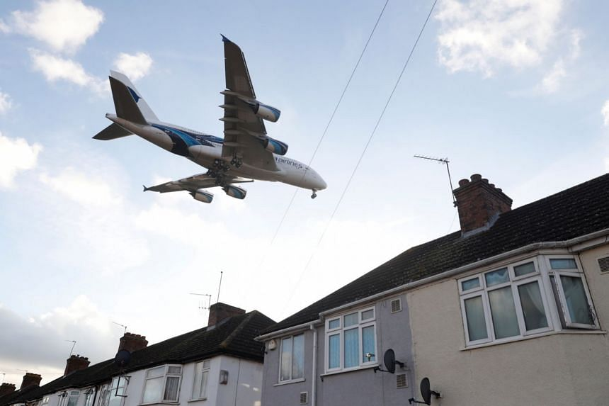 A Malaysia Airlines Airbus A380-841 passes over homes in Waye Avenue as it comes into land at Heathrow Airport, London, Britain, on Jan 10, 2018.