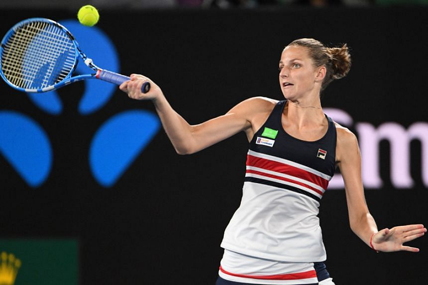 Czech Republic's Karolina Pliskova plays a forehand return during her women's singles fourth round match against Czech Republic's Barbora Strycova on the eighth day of the Australian Open in Melbourne on Jan 23.