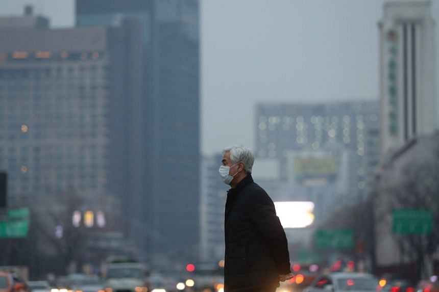 A man wears a surgical mask in Seoul on Jan 16, as the density of fine dust in the air is forecast to be 'bad' nationwide.