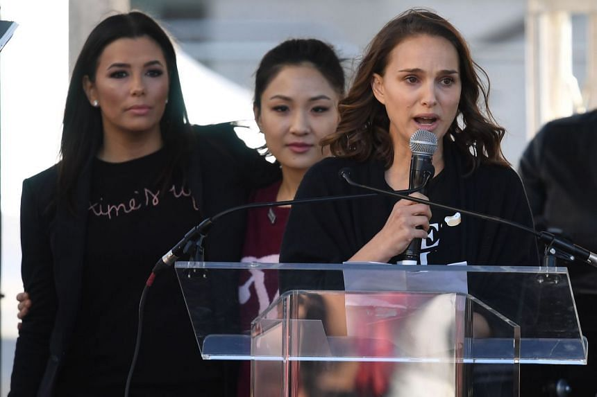 (From left) Actresses Eva Longoria, Constance Wu and Natalie Portman speak to the 500,000 strong crowd during the Women's Rally, in Los Angeles, California.