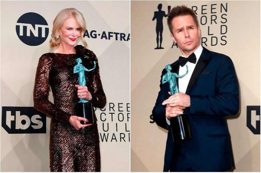 Winners Nicole Kidman (left) and Sam Rockwell pose with their SAG Award trophies during the 24th annual Screen Actors Guild Awards ceremony in Los Angeles on Jan 21, 2018.