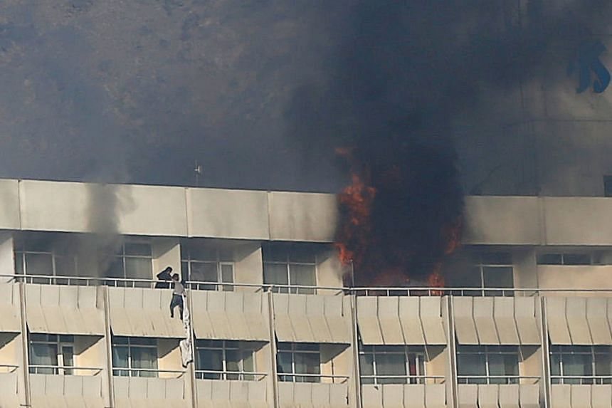 A man trying to escape from the Intercontinental Hotel. Hotel guests shimmied down from upper-floor windows via sheets that had been tied together.
