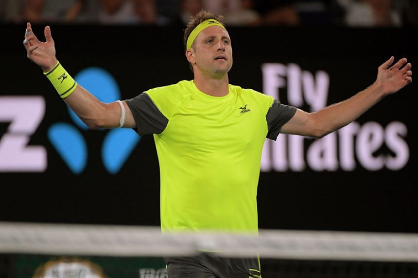 Tennys Sandgren of the United States celebrates winning his round of 16 match against Dominic Thiem of Austria at the Australian Open in Melbourne on Jan 22.