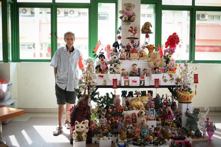 Mr Or Beng Kooi with the latest iteration of his toy tower.