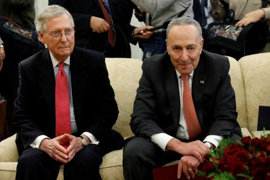 Senate Democratic leader Chuck Schumer (right) said he had come to an arrangement with Senate Majority Leader Mitch McConnell to keep the government open for the next few weeks.