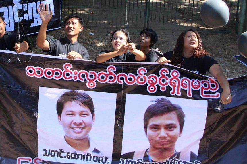 Supporters take part in a protest outside the court where Reuters journalists Wa Lone (left in banner) and Kyaw Soe Oo attend a hearing in Yangon, Myanmar, on Jan 10, 2018.