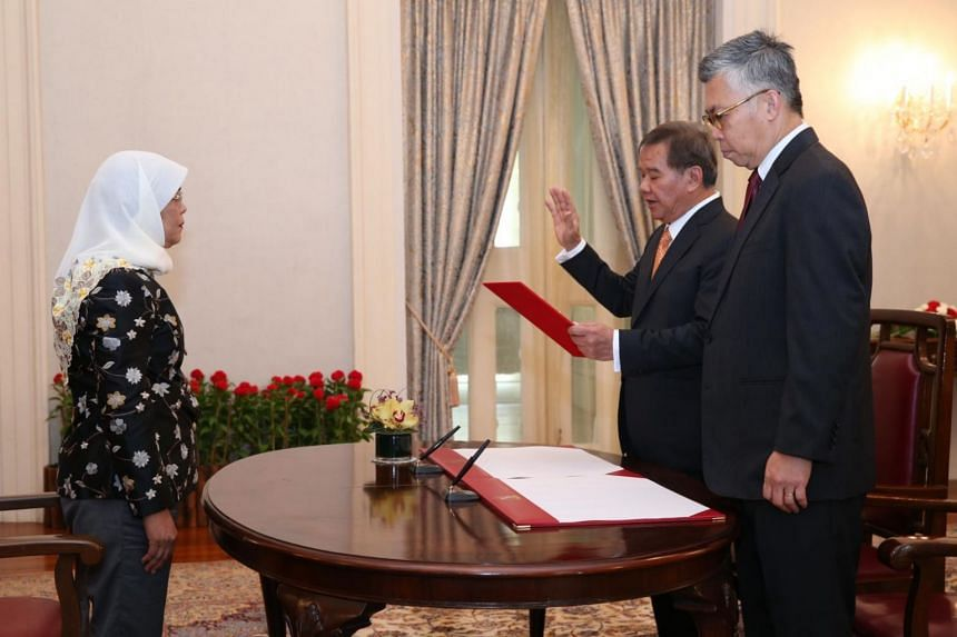 During a ceremony at the Istana officiated by President Halimah Yacob, Abdullah Tarmugi (second from right) was presented with his letter of appointment and took his oath before Justice Steven Chong.