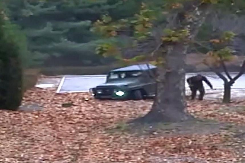 The North Korea defector running out from a vehicle at the Joint Security Area of the Demilitarised Zone at the truce village of Panmunjom.