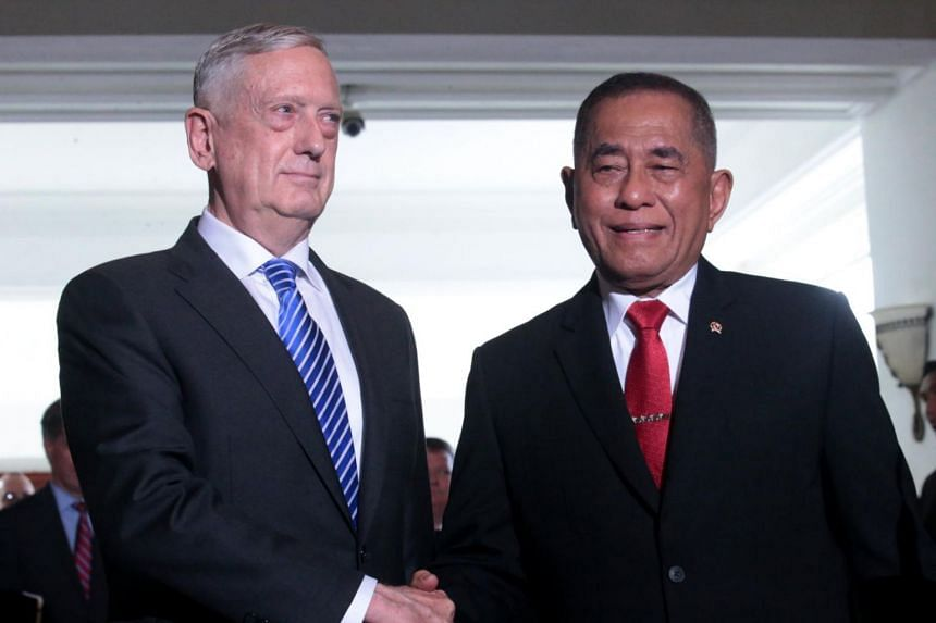 US Secretary of Defence Jim Mattis (left) shakes hands with Indonesian Minister of Defence Ryamizard Ryacudu during their meeting in Jakarta, Indonesia, on Jan 23, 2018.