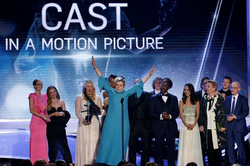 The cast of Three Billboards Outside Ebbing, Missouri receive the award for Outstanding Performance by a Cast in a Motion Picture at the Screen Actors Guild Awards on Jan 21.