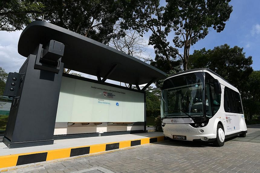 The NTU-Blue Solutions Flash Shuttle - recharging at a stop at the university's Halls of Residence at North Hill - was launched yesterday. It will run a 1km test route with two stops.